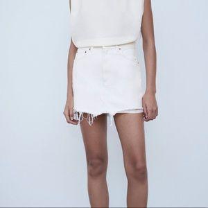 luxurious high waisted mini denim skirt rip detail